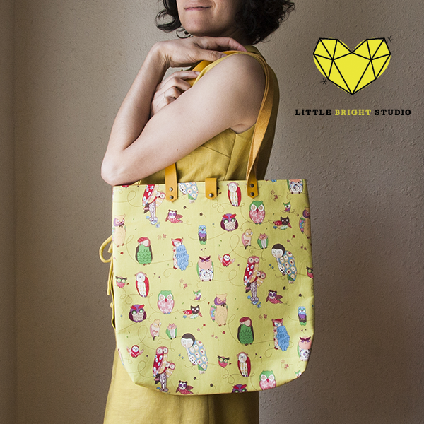 tote bag featuring whimsical owls